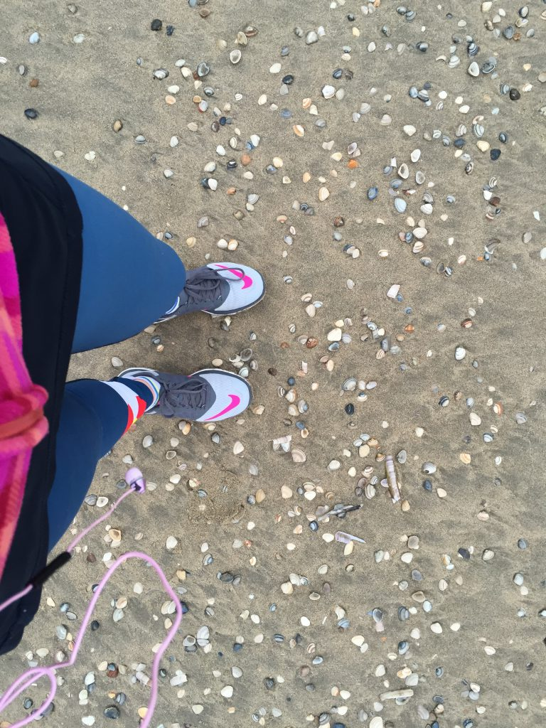 Running on the seashells on the shore of the North Sea in Amsterdam