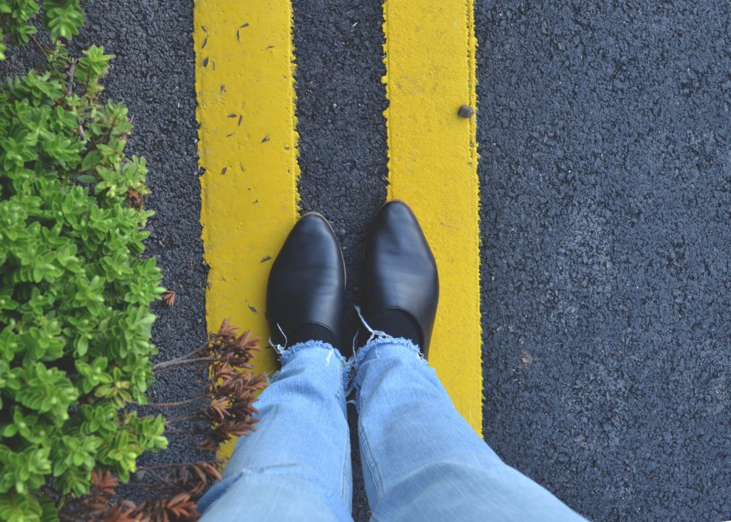 shoes on yellow stripes