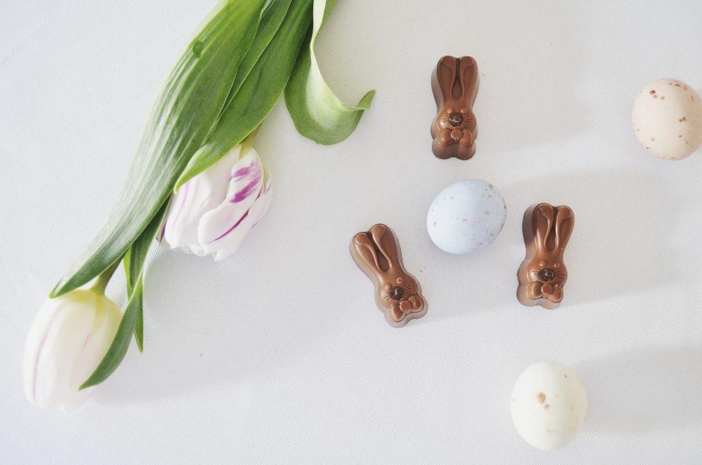 Happy Easter, chocolate bunnies, chocolate eggs, tulips